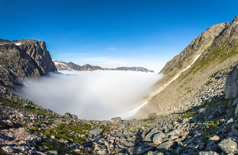 Fogbow Hiking Adventure Beauty In Nature Blue Blue Sky Day Fog Foggy Idyllic Landscape Mountain Mountain Range Nature No People Outdoors Physical Geography Remote Rock - Object Scenics Sky Tranquil Scene Tranquility Water Waterfall