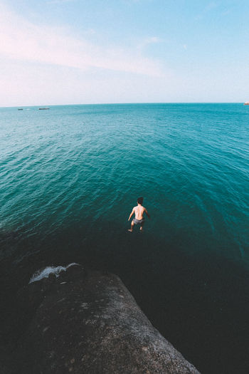 High Angle View Of Man Diving In Sea