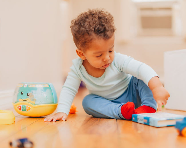 Boy playing with toy on table at home