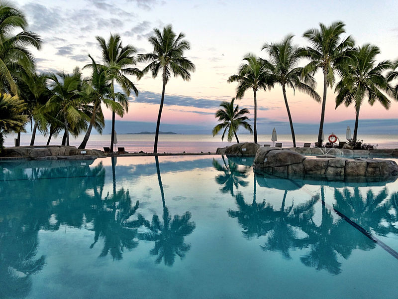 Beach Beauty In Nature Day Idyllic Infinity Pool Luxury Nature No People Outdoors Palm Tree Reflection Relaxation Scenics Sea Sky Sunset Swimming Pool Tourist Resort Tranquil Scene Tranquility Travel Tree Tropical Climate Vacations Water