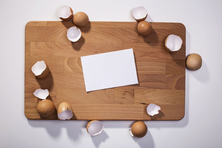 Wooden cutting board with egg shells and blank paper note. Cooking recipe, ingredients, copy space Albumina Blank Chef Cookbook Cracked Cuisine Cutting Board Eggs Food Kitchen Utensils Mayonnaise Note Preparation  Recipe Recipe Photo Recipes First Eyeem Photo
