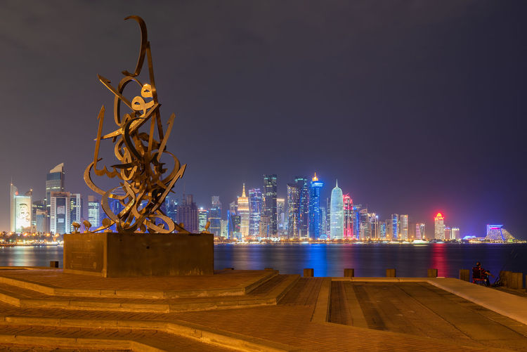 Doha, Qatar Architecture Sculpture Building Exterior City Illuminated Built Structure Statue Art And Craft Representation Sky Night Building Nature Cityscape Creativity Human Representation Skyscraper Water Office Building Exterior Tall - High No People Modern Outdoors Doha Qatar Middle East Travel