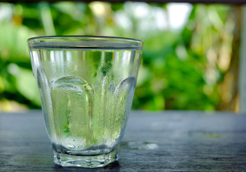 A glass of cold water on nature background. Thirsty  Bevarage Cold Temperature Drink Drinking Glass Freshness Glass Healthy Healthy Eating Heat - Temperature Purified Water Purity Refreshing Refreshment Splash Summer Water Wellbeing
