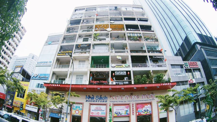 Architecture Building Exterior Built Structure Business Finance And Industry Cafe Cafe Latte Cafe Time City Cozy Day Low Angle View Modern No People Outdoors Relax Relaxing Saigon Skyscraper Travel Destinations Tree Vietnam Window