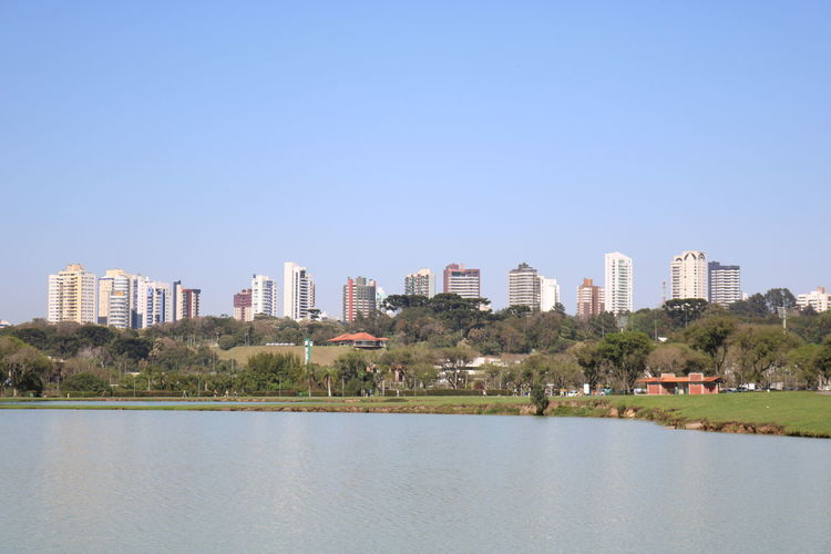 Scenic View Of Buildings Against Clear Blue Sky