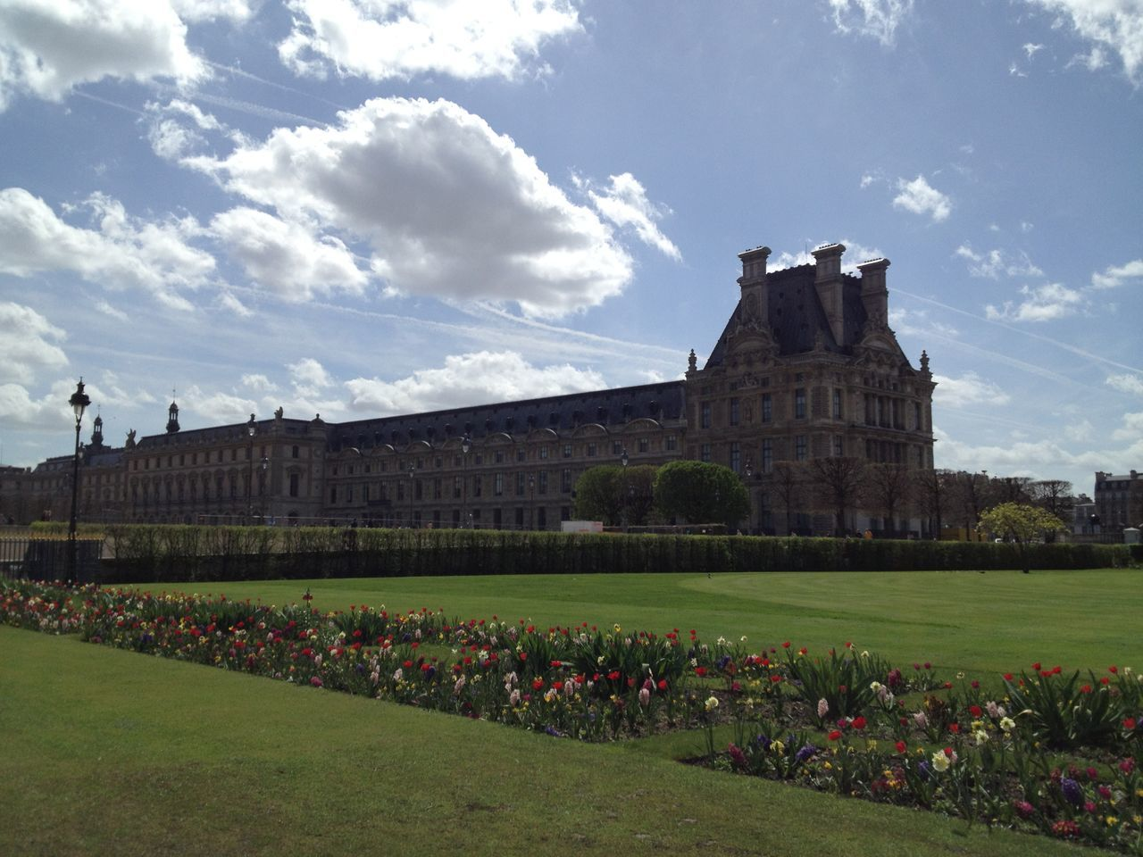 architecture, built structure, history, sky, grass, building exterior, day, outdoors, no people, nature, flower