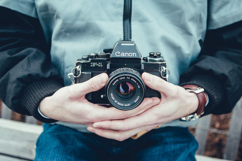 Camera Camera - Photographic Equipment Close-up Day Digital Camera Digital Single-lens Reflex Camera Focus On Foreground Holding Human Body Part Human Hand Men Midsection One Person Outdoors People Photographer Photographing Photography Themes Real People SLR Camera Technology