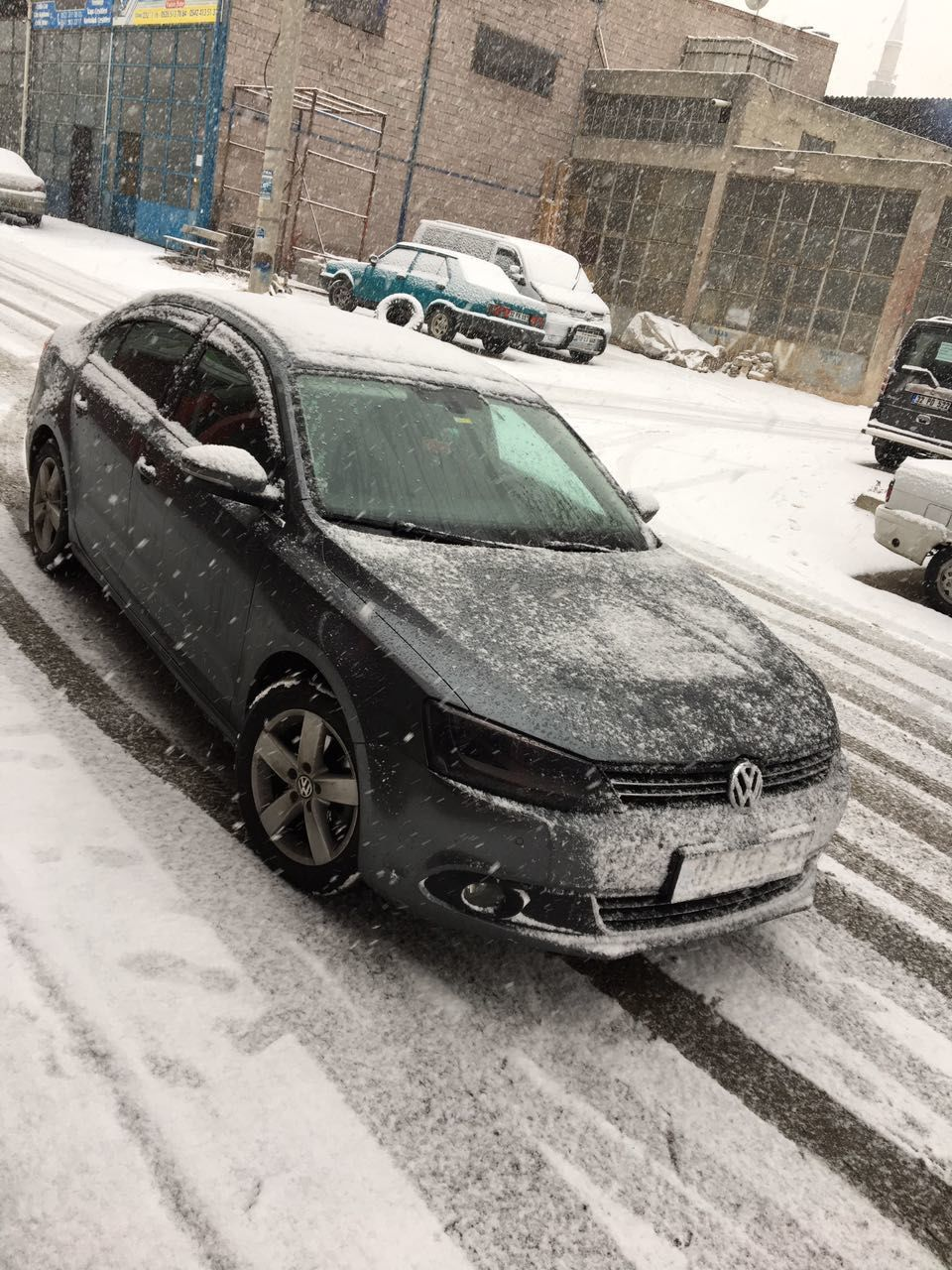 CLOSE-UP OF CAR ON SNOW COVERED CARS