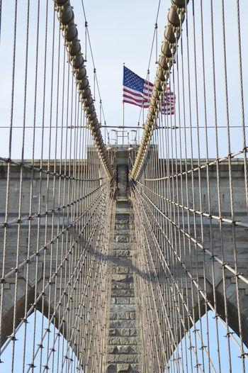 Low angle view of flag on bridge