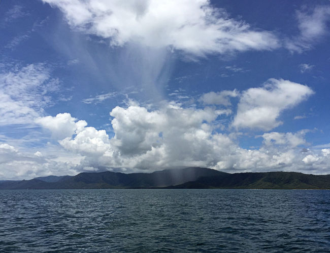 Passing Shower Raindrops Weather Weather Photography Beauty In Nature Blue Cloud - Sky Day Idyllic Mountain Mountain Range Nature No People Outdoors Non-urban Scene Outdoors Passing Shower Remote Scenics - Nature Sea Seascape Seascape Skyscape Sky Tranquil Scene Tranquility Water Weather Condition