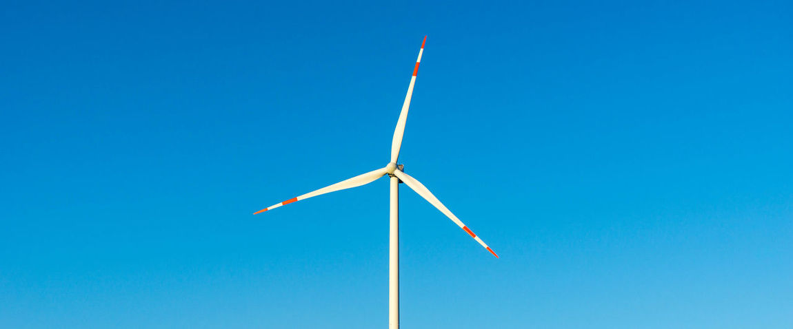 isolated wind turbine and blue sky Alternative Energy Beauty In Nature Blue Clear Sky Copy Space Day Electricity  Environment Environmental Conservation Fuel And Power Generation Low Angle View No People Outdoors Renewable Energy Sky Sustainable Resources Technology Turbine Wind Power Wind Turbine