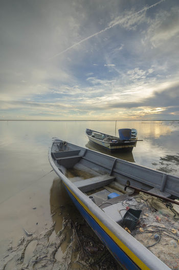 Fisherman boat near the sea Beach Beauty In Nature Cloud - Sky Fishing Boat Horizon Over Water Land Mode Of Transportation Moored Nature Nautical Vessel No People Outdoors Rowboat Sand Scenics - Nature Sea Sky Sunset Tranquil Scene Tranquility Transportation Water
