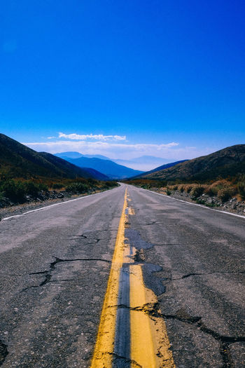 Forward Road Asphalt Beauty In Nature Blue Car Clear Sky Day Dividing Line Landscape Mountain Mountain Range Nature No People Openmind Outdoors Road Road Marking Scenics Sky Sunlight The Way Forward Tranquil Scene Tranquility Transportation Lost In The Landscape Go Higher