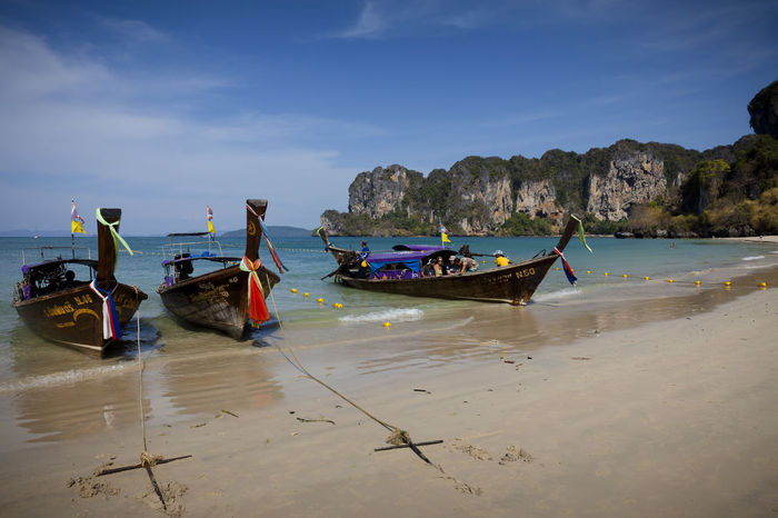 Three traditional looking boats at the beach in Krabi, Thailand. Beach Day Boats Fishing Holiday Trip Island Sunlight Thailand Tour Tourism Tourist Attraction  Traditional Fishing Boat Travel Destinations