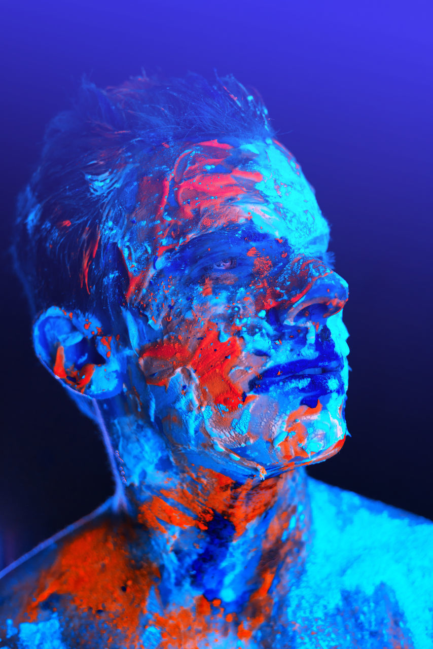 blue, studio shot, water, multi colored, one person, portrait, indoors, adult, headshot, vibrant color, nature, motion, paint, close-up, futuristic