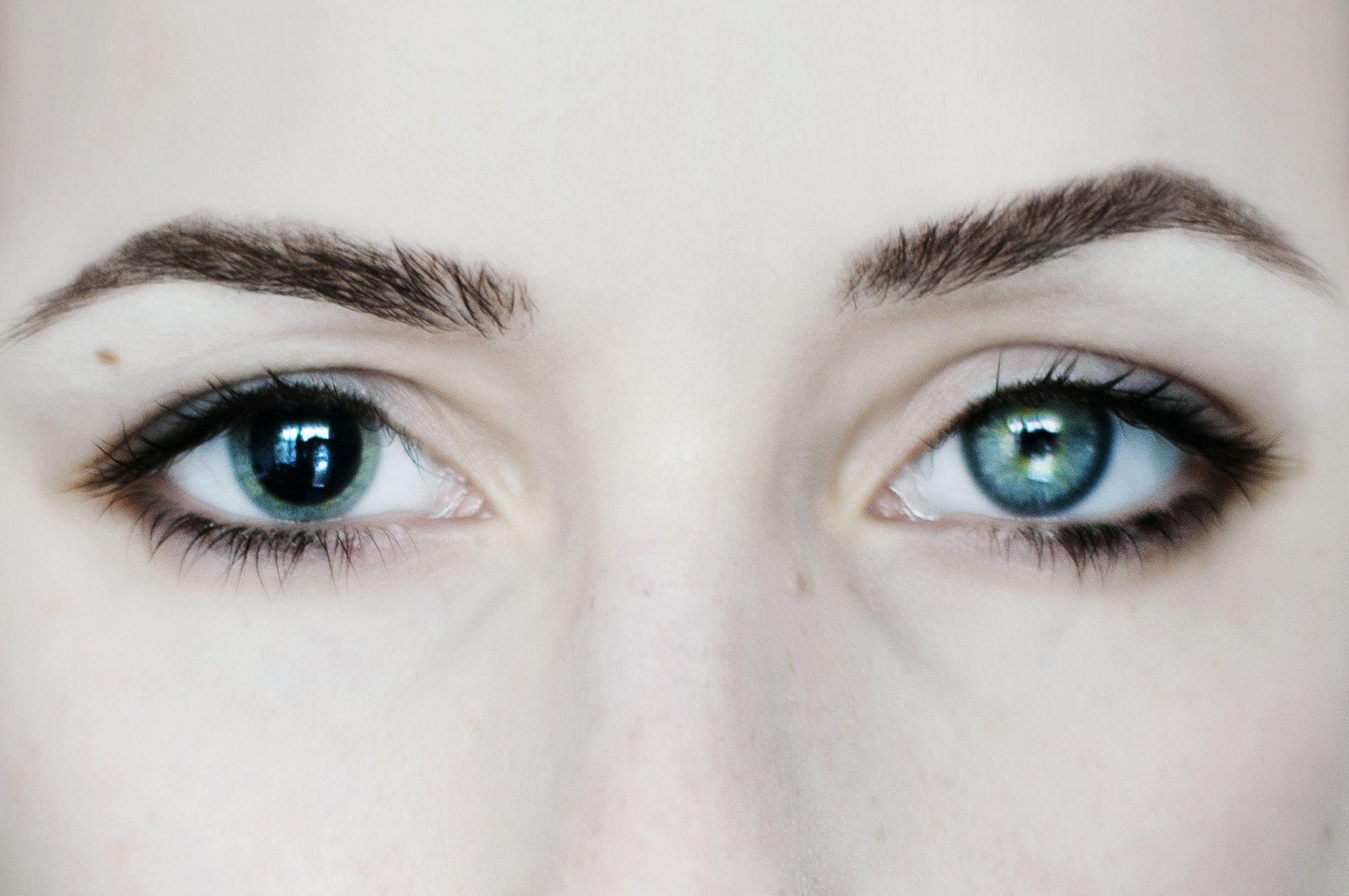 human eye, close-up, eyelash, portrait, human face, eyesight, part of, headshot, lifestyles, sensory perception, human skin, iris - eye, extreme close-up, extreme close up, staring, detail, cropped, full frame