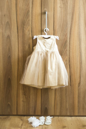 christening dress and shoes Christening Absence Celebration Christening Day Christening 💙 Clothing Coathanger Crumpled Paper Ball Dress Fashion Flooring Furniture Hanging Hardwood Floor Indoors  No People Paper Shoes Table Two Objects White Color Wood Wood - Material Wood Grain