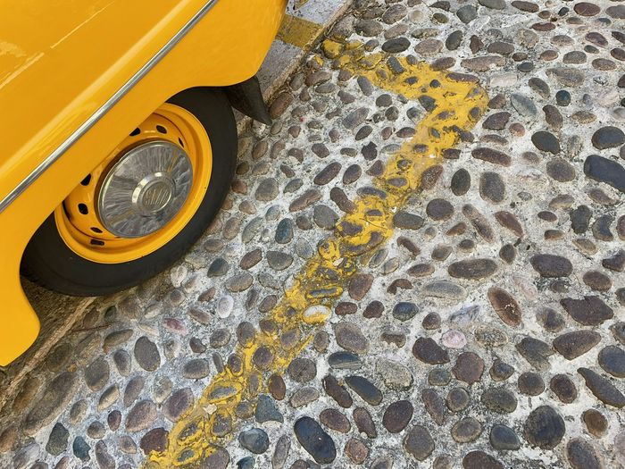 High angle view of yellow car on floor