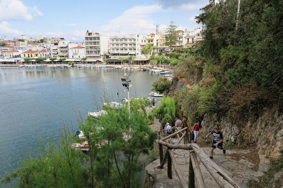 Agios Nikolaos, Crete / GREECE May 22 2017: Cityscape of Agios Nikolaos (Crete Greece). boats at volcano lake voulismeni. Traditional houses around the caldera with restaurants and stores. Agios Nikolaos Architecture Building Exterior Built Structure Cityscape Crete Crete Greece Crete Island Greece Greece, Crete Lake Nature Outdoors Real People Voulismeni Water