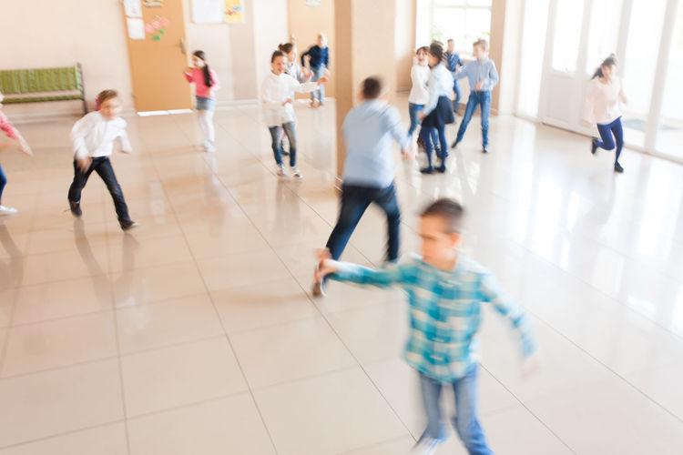 Kids running in school corridor
