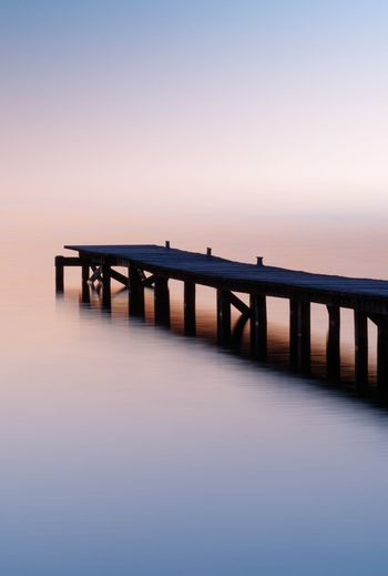 Low Light Long Exposure Ripples Reflection Blue Pink Gradient Ponton Water Sky Sea Tranquility Scenics - Nature Tranquil Scene Sunset Built Structure Nature Horizon Horizon Over Water Pier Beauty In Nature No People Bridge