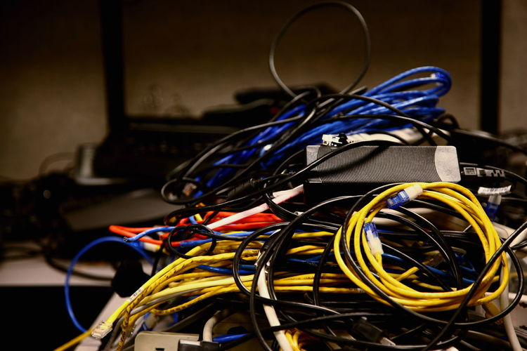 Close-up of tangled cables in server room