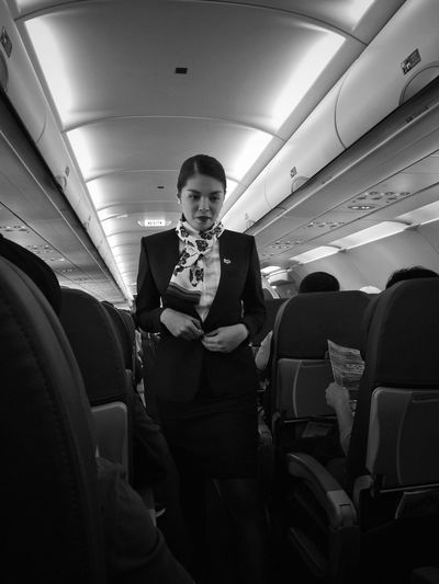 The Attendant Mode Of Transportation Transportation Vehicle Interior Travel One Person Air Vehicle #urbanana: The Urban Playground Real People Seat Airplane Three Quarter Length Portrait Indoors  Women Lifestyles Front View