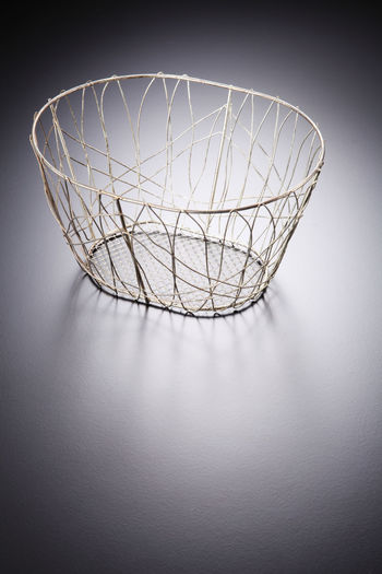 High angle view of empty yellow basket on gray table