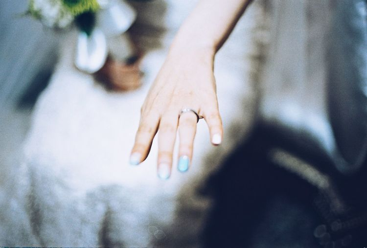 Close-Up Of Bride Showing Wedding Ring