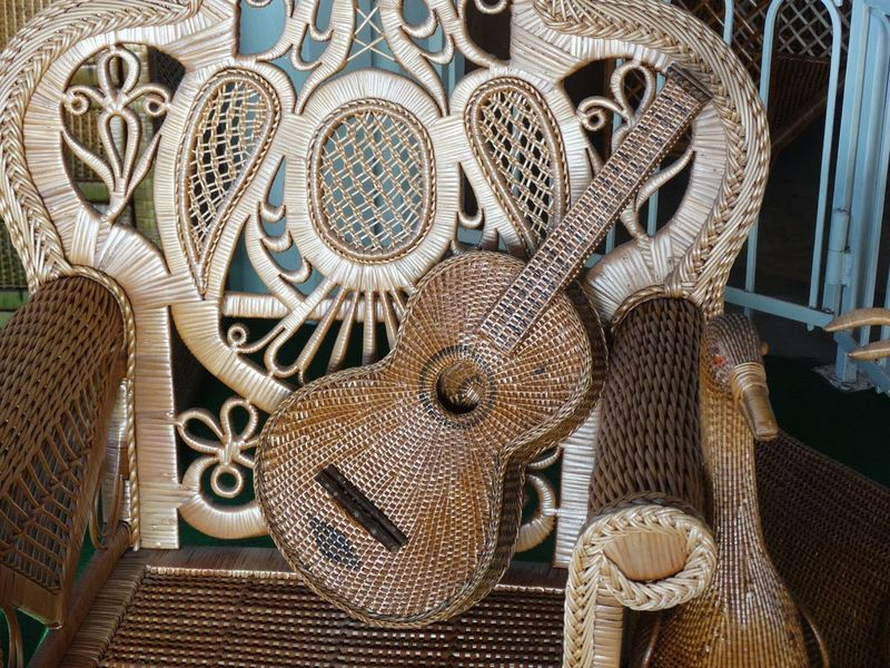 Wicker work. Creativity Woven Handmade Shop Art And Craft Crafts Chair Instrument Music Guitar Wicker Work Arts And Crafts Arts Culture And Entertainment Art Craft Wicker Indoors  No People Day Close-up