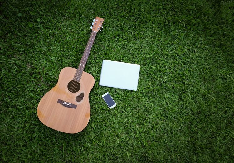 High Angle View Of Guitar On Field