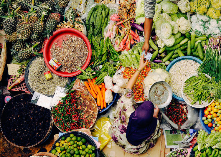 High angle view of woman selling vegetables at market