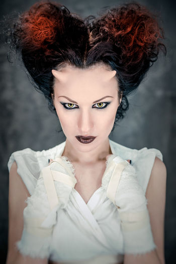 Portrait of beautiful horned woman with bright make up, conceptual photo Art Attractive Brunette Girl  Caucasian Conceptual Demon Demonic Devil Face Fantasy Female Hairstyle Hell Horned Horns Lens Looking At Camera Makeup Mysterious Portrait Of A Woman Satan Studio Shot Witch Woman Young