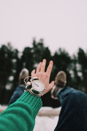Clock Forest Clock Hand Winter Human Hand Hand Real People Focus On Foreground Human Body Part Finger Lifestyles Body Part Tree Day Human Finger Warm Clothing Nature