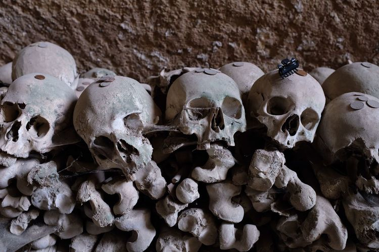 High Angle View Of Human Skulls At Cemetery