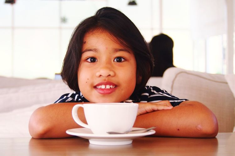 Little girl with a cup of coffee People ASIA Asian  Girl Post Family❤ Sister ❤ Kids Smile Thailand Child Portrait Childhood Drink Domestic Room Girls Headshot Looking At Camera Milk Smiling Tea Eye Color Hot Drink Black Coffee Mocha Cafe Macchiato Black Tea Tea Cup Coffee Tea - Hot Drink