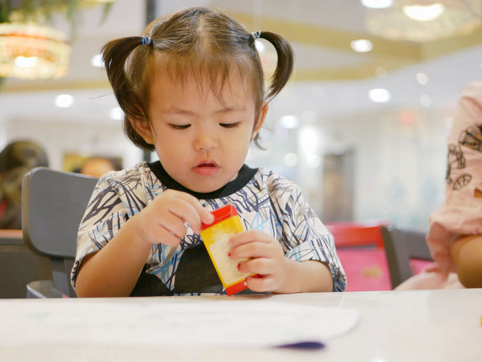 Little Asian baby girl learning to open crayon box by herself Child Childhood Learning Open Box Crayons Asian  Baby Girl Kid Young Toddler  Cute Adorable Hands Skill  Develop Development Sitting By Herself Take Enjoy Concentrate Attention Muscle