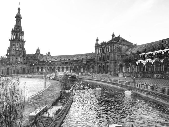 Architecture Building Exterior Built Structure Travel Destinations Water Travel City Tourism River History Clear Sky Outdoors Sky Day Sculpture Statue No People Architectural Detail Seville,spain Architecturelovers Architecture Photography EyeEm Best Shots - Architecture Photooftheday Architecture EyeEm Best Shots - Black + White Welcome To Black The Architect - 2017 EyeEm Awards Live For The Story Live For The Story The Architect - 2017 EyeEm Awards