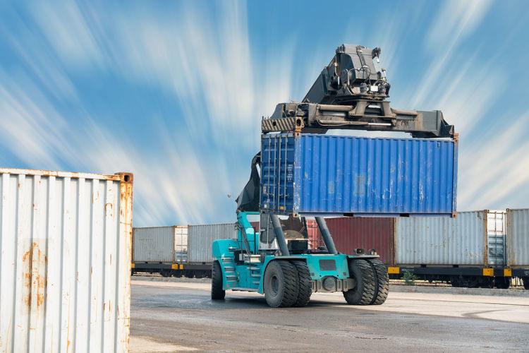 Logistics and shipping yard Business Container Container Ship Distribution Forklift Goods Industrial Industry Lifting Loading Dock Logistics Machinery Mechanic Sky And Clouds Transport Transportation Export Import Management Movement Shipping Docks Shipping Yard Storage Train Truck
