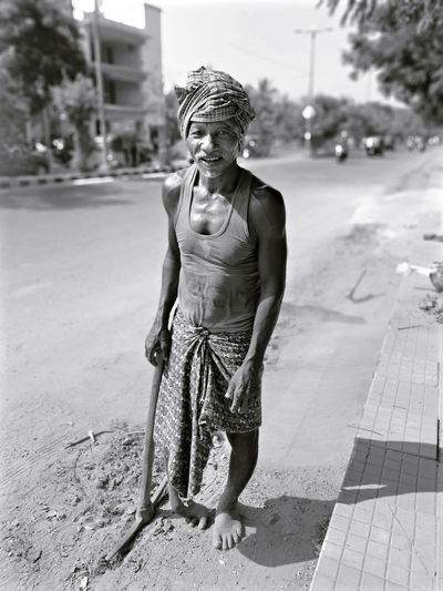 Portrait of smiling worker standing on street