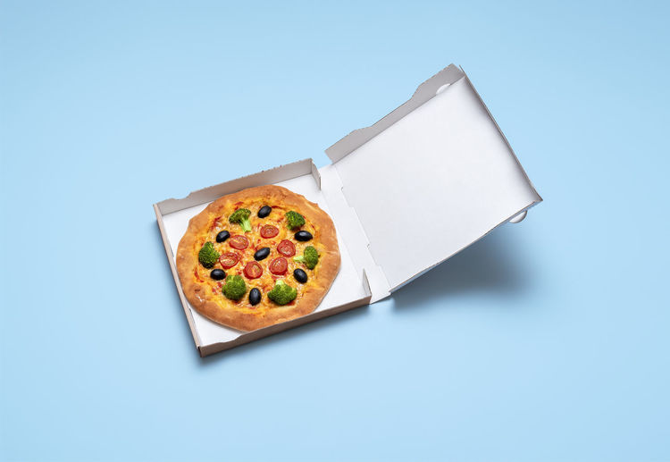 High angle view of food on table against blue background