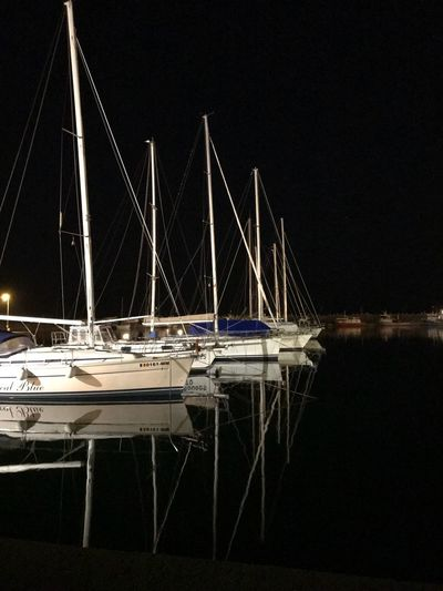 Shiny boats Evening Dark Black Sea And Sky Boats Vision Lighty Nightview Water Night Transportation Reflection No People Nautical Vessel Illuminated Sky Outdoors Sea Sailboat Travel Nightlife