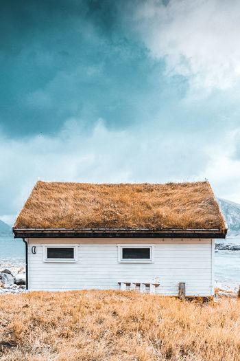 House on field against sky