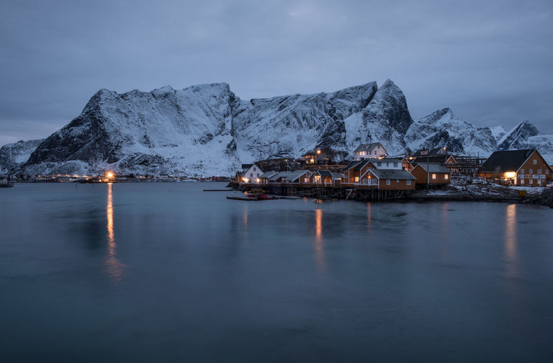 Yellow houses in Reine Artic Cloudy Sky Hamnøya Lights Lofoten Norway Lofoten Islands Norway Reflection Reine Winter Blue Coast Hamnøy House Long Exposure Long Exposure Night Photography Mountain Pollen Port Sea Snow White Yellow