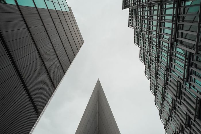 Architecture Building Building Exterior Built Structure Capital Cities  City City Life Dark Day Directly Below Financial District  Geometric Shapes Geometry Glass - Material Low Angle View Modern Office Building Pattern Pattern Design Pattern, Texture, Shape And Form Reflection Sky Spire  Tall Window