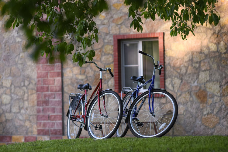 Two bicycles Bicycle Trip Cyclist Wheel Activity Bicycle Bicycles Bicycling Bike Bikes Brick Wall House Land Vehicle Leisure Activity Mode Of Transportation No People Outdoors Sport Transportation Wheel Wheels