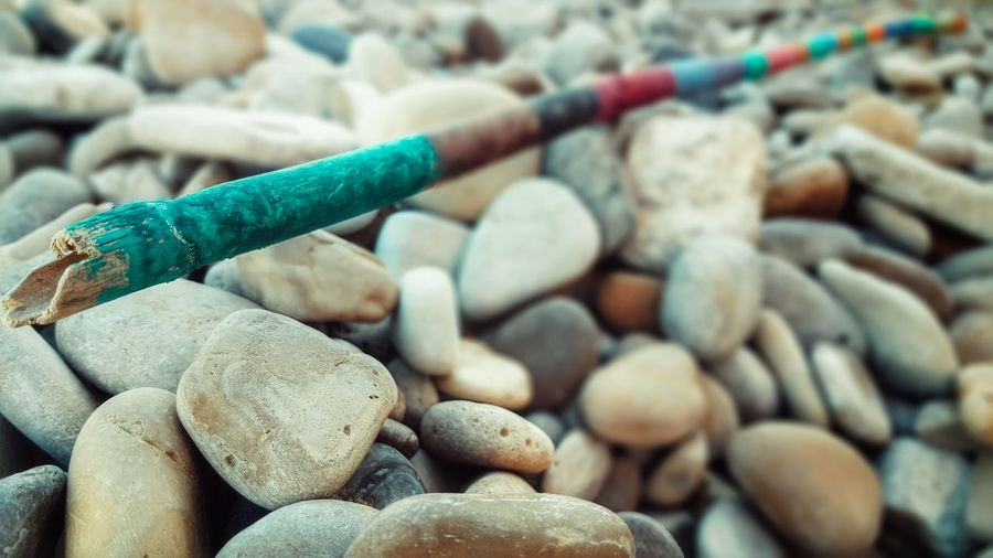 HandPainted Wood Rod Colors Colorful Beachphotography Beach Life Simple Things In Life Relaxing Taking Photos Handpainting Painted Wood Selective Focus Focus On Foreground Abundance Beach Stones Stones Summertime On The Beach Malephotographerofthemonth - Greek Islands Chios Greece