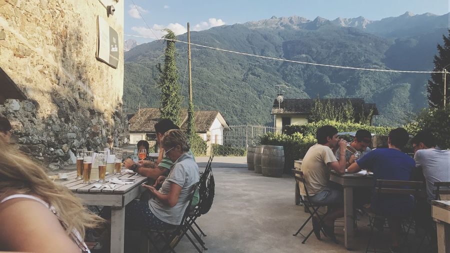 Travel Mountain Restaurant Chair Table Food And Drink Sitting Cafe Outdoors Lifestyles Day Mountain Range Friendship Real People Nature