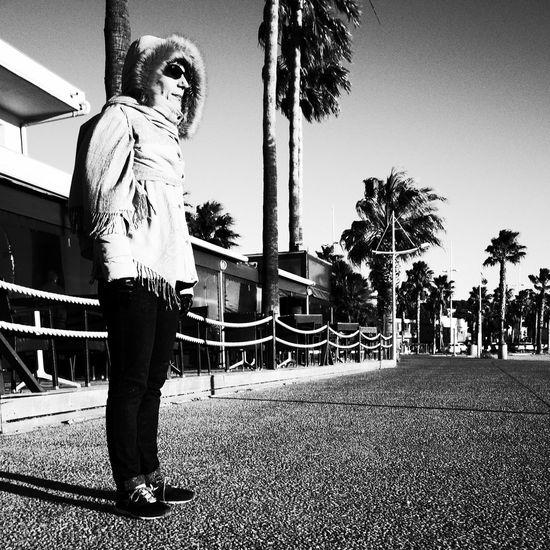 Noir Et Blanc Blackadnwhite Building Exterior Day Full Length High Contrast One Person Outdoors Palm Tree Real People Sky Standing Street Photography Streetphotography Sunglasses Women