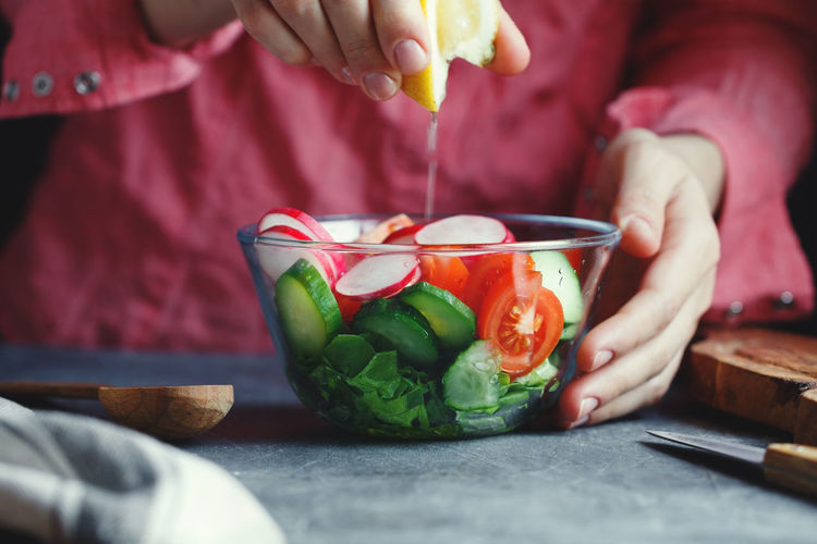 Bowl Close-up Day Food Food And Drink Freshness Healthy Eating Holding Human Body Part Human Hand Indoors  Midsection One Person People Preparation  Real People Vegetable